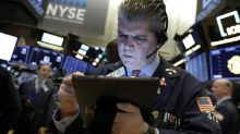 Asian shares mixed after US stocks retreat from record high