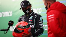 Lewis Hamilton presented with Michael Schumacher's helmet by son Mick to honour record-equalling 91st career victory