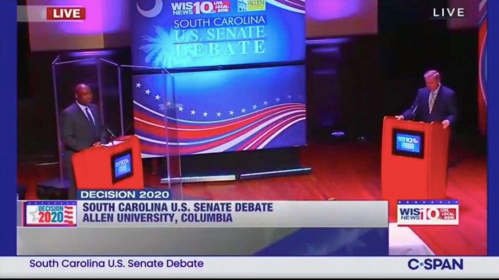 Plexiglass separates Jaime Harrison and Lindsey Graham during debate