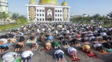 Muslims perform Eid prayers with social distancing, masks