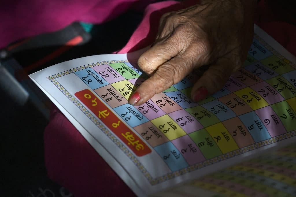 "For the elderly women attending Maharashtra's ""school for grannies"" removes the stigma of illiteracy (AFP Photo/Indranil MUKHERJEE)"