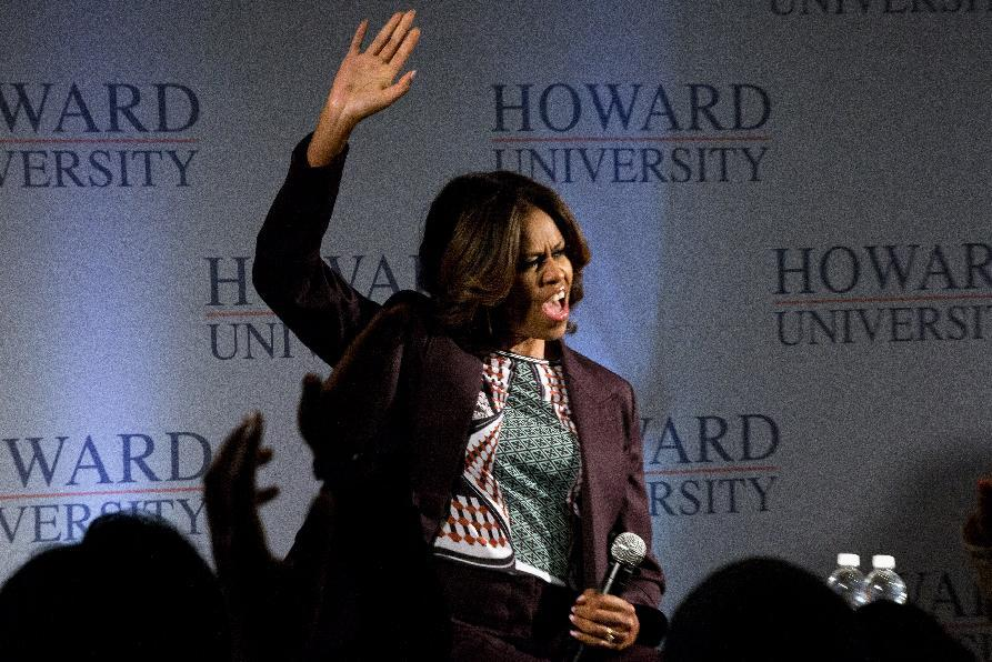 First lady Michelle Obama cheers as she arrives for a town hall meeting at Howard University in Washington, Thursday April 17, 2014. The first lady joined juniors and seniors from Chicago public high schools on the first day of their four-day visit to Howard University, as part of a program to immerse talented high school students in a college campus environment. (AP Photo/Jacquelyn Martin)