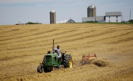 FILE PHOTO: A farmer harvests his field at his farm in Pecatonica