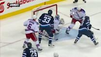Dustin Byfuglien bats puck in out of mid-air