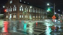 Burst water main floods downtown intersection and nearby parking garage