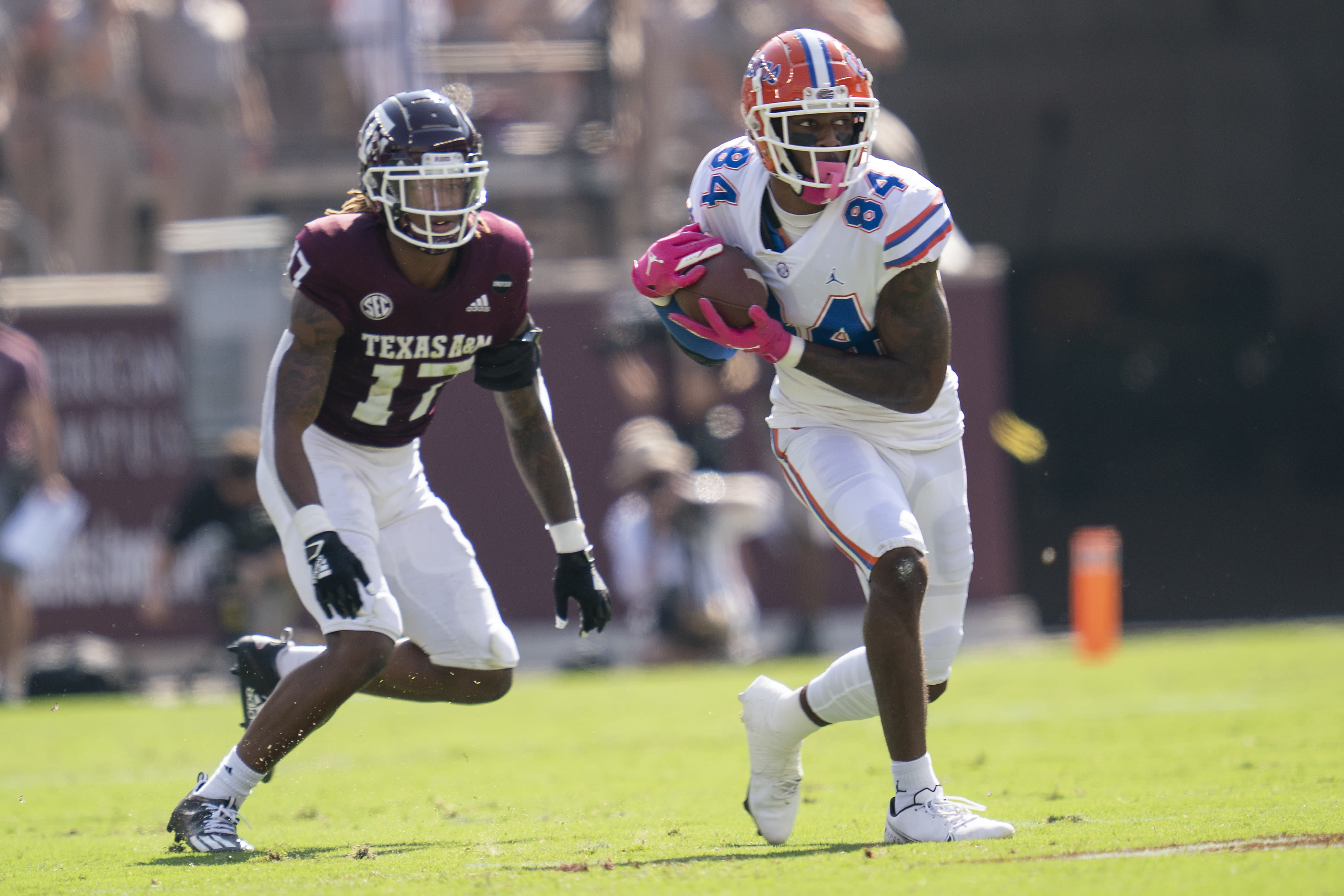 Florida tight end Kyle Pitts (84) catches a pass as Texas A&M defensive back Jaylon Jones (17) defends during the first quarter of an NCAA college football game, Saturday, Oct. 10, 2020. in College Station, Texas. (AP Photo/Sam Craft)
