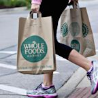 Wal-Mart could enter a bidding war with Amazon over Whole Foods, JPMorgan says