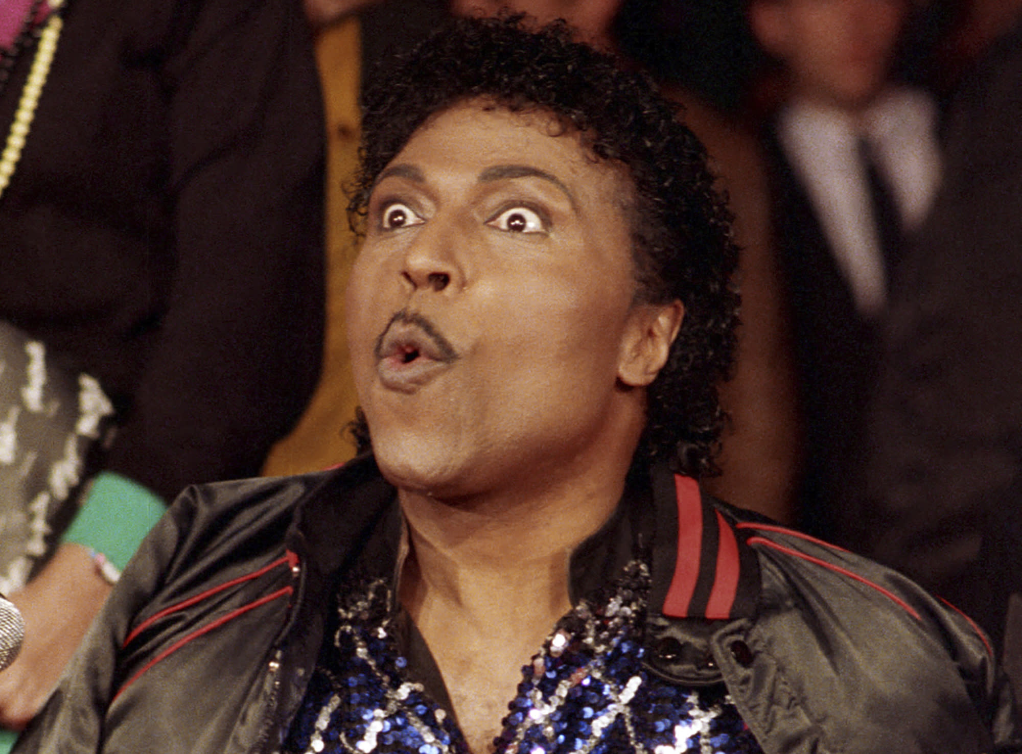 """FILE - In this Nov. 13, 1986 file photo, Little Richard poses for the cameras as he is inducted into Rock Walk, a sidewalk collection of handprints and signatures of rock and roll musicians, in Los Angeles. Little Richard, the self-proclaimed """"architect of rock 'n' roll"""" whose piercing wail, pounding piano and towering pompadour irrevocably altered popular music while introducing black R&B to white America, has died Saturday, May 9, 2020. (AP Photo/Mark Avery, File)"""