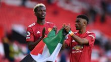 Paul Pogba and Amad Diallo hold up Palestine flag after Manchester United's draw with Fulham