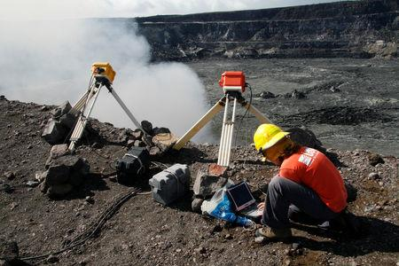 Kelly Wooten, a geologist and volcanologist at Hawaiian Volcano Observatory (HVO) is downloading radiometer data on rim of Halema'uma'u Crater in Kilauea Volcano, Hawaii, U.S., December 19, 2008. Picture taken on December 19, 2008. Courtesy USGS/Handout via REUTERS
