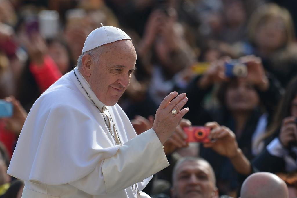 Pope Francis greets worshippers at St Peter's Square in the Vatican, on March 4, 2015