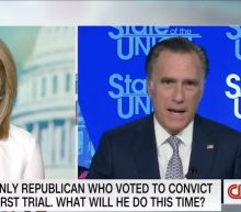 Romney tight-lipped on impeachment vote, but says Trump's actions warrant trial