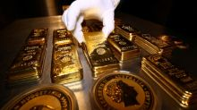 Gold climbs to two-week high as virus fears spark safety buying