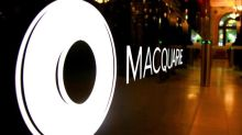 Australia's Macquarie posts record H1 profit, shares jump to record high