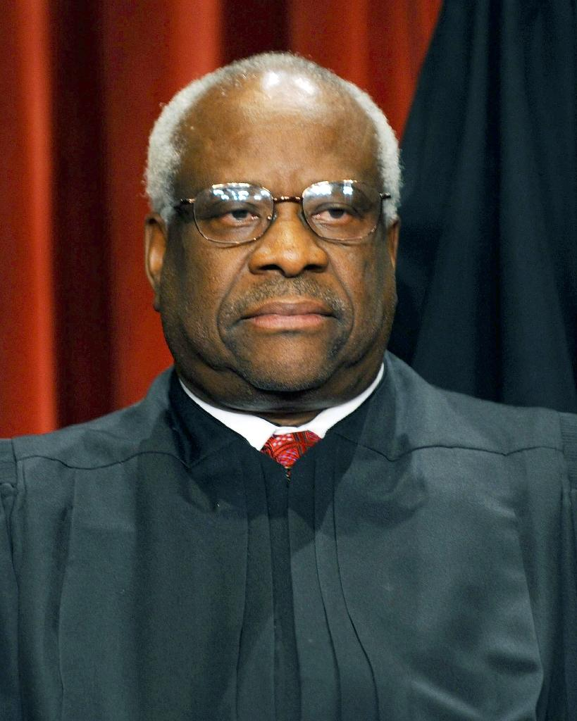 US Supreme Court Associate Justice Clarence Thomas participates in the courts official photo session on October 8, 2010 at the Supreme Court in Washington, DC (AFP Photo/Tim Sloan)