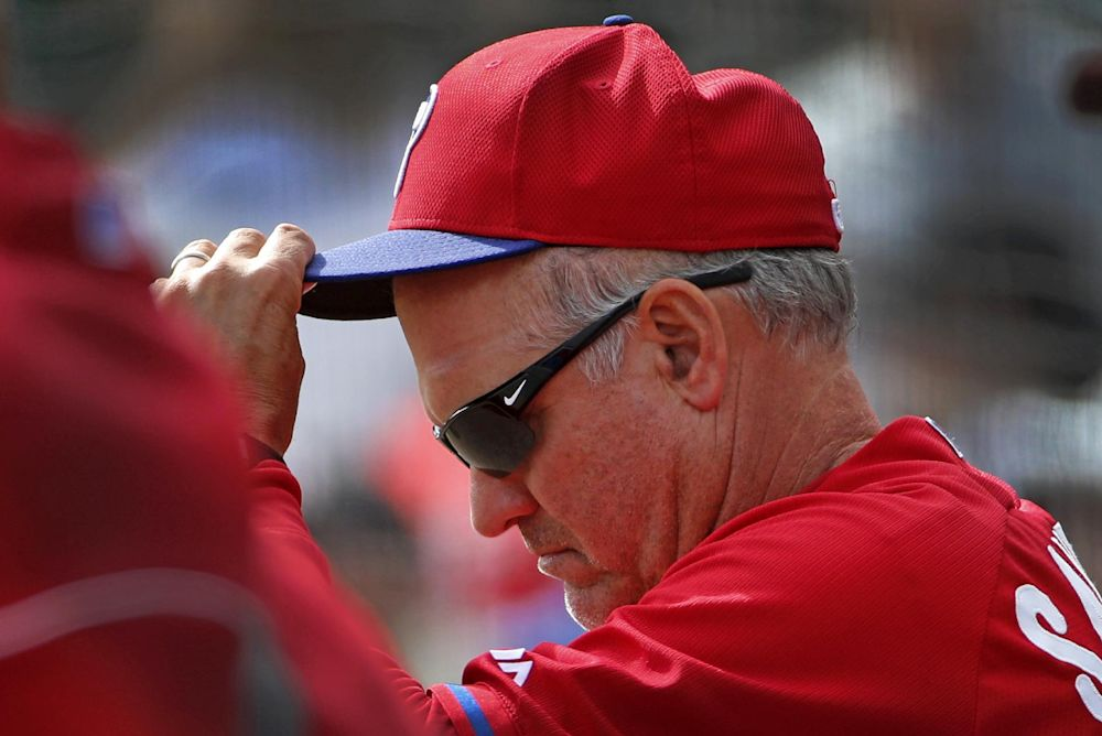 Philadelphia Phillies manager Ryne Sandberg stands in the dugout during the Phillies' exhibition baseball game against the Baltimore Orioles in Sarasota, Fla., Friday, March 7, 2014. The Orioles won 15-4