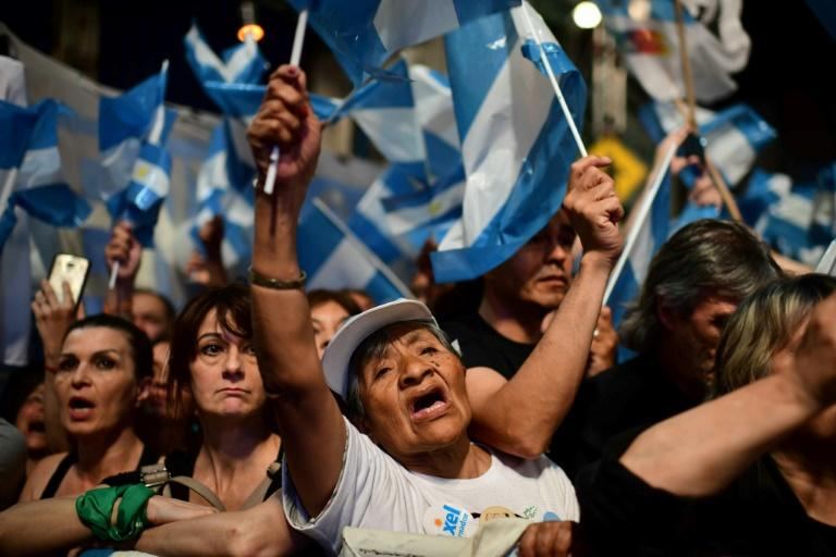 Supporters of Argentine presidential election winner Alberto Fernandez celebrate his victory in Buenos Aires (AFP Photo/RONALDO SCHEMIDT)