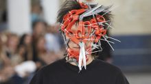 A model just took to the catwalk at London Fashion Week Men's with scissors on his face