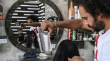 With cleavers and blowtorches, Pakistan barber offers hair-raising cuts