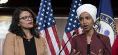 U.S. Rep. Ilhan Omar, D-Minn, right, speaks, as U.S. Rep. Rashida Tlaib, D-Mich. listens. (AP)