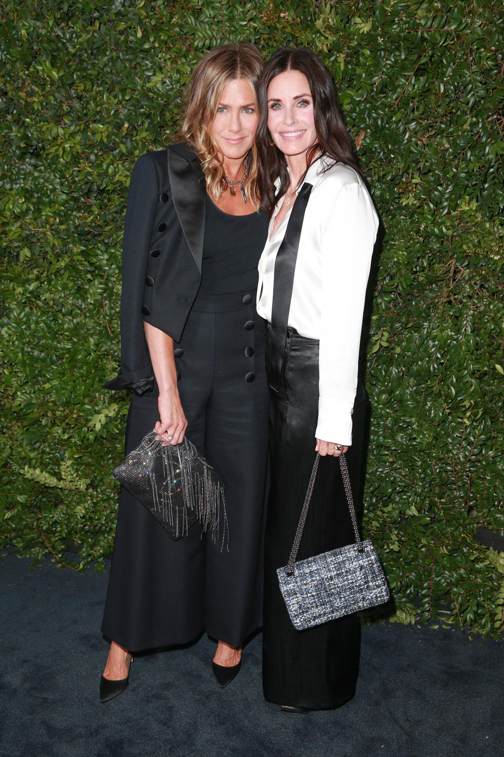 MALIBU, CA - JUNE 02:  Jennifer Aniston (L) and Courtney Cox attend the CHANEL Dinner Celebrating Our Majestic Oceans, A Benefit For NRDC on June 2, 2018 in Malibu, California.  (Photo by Rich Fury/Getty Images)