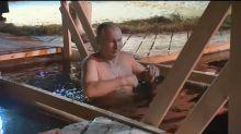 Shirtless Putin celebrates Epiphany with dip in frozen lake