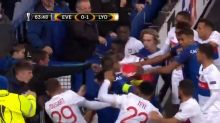 Everton fan appears to throw punch at Lyon player while holding child during fight triggered by Ashley Williams tackle