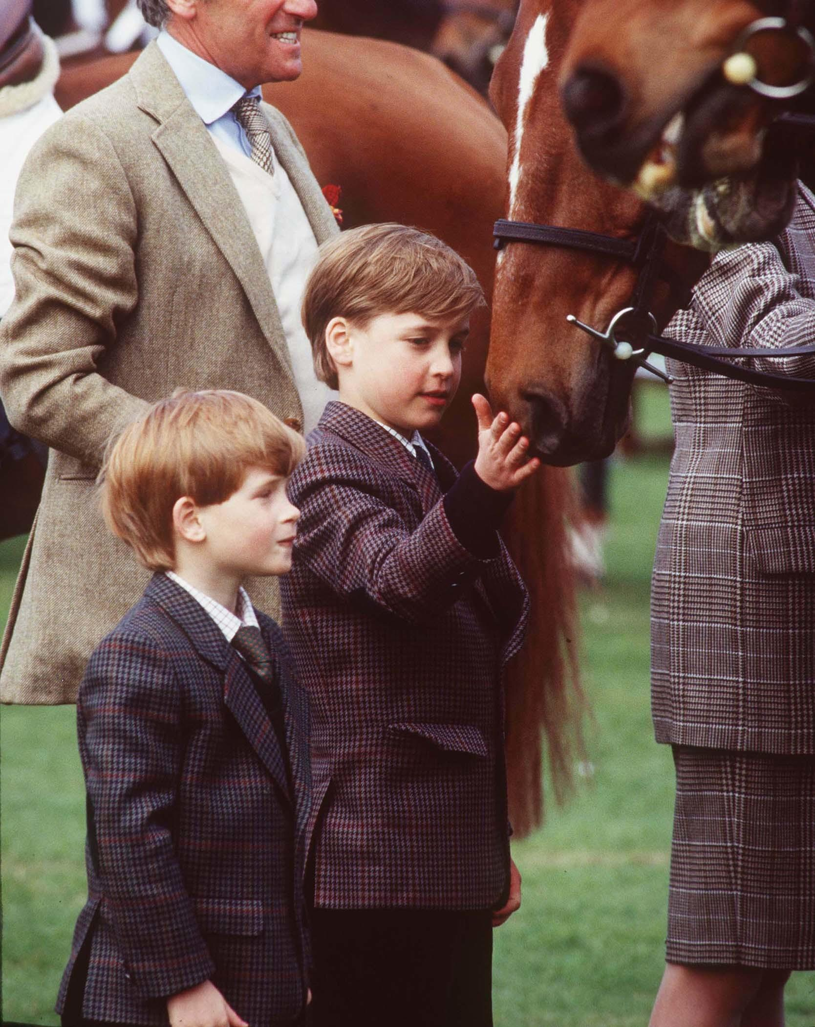 BADMINTON - MAY: (FILE PHOTO) Prince William and Prince Harry pat a horse when the visit the Badminton Horse Trials in May, 1991 in Badminton, England.  (Photo by Anwar Hussein/Getty Images)