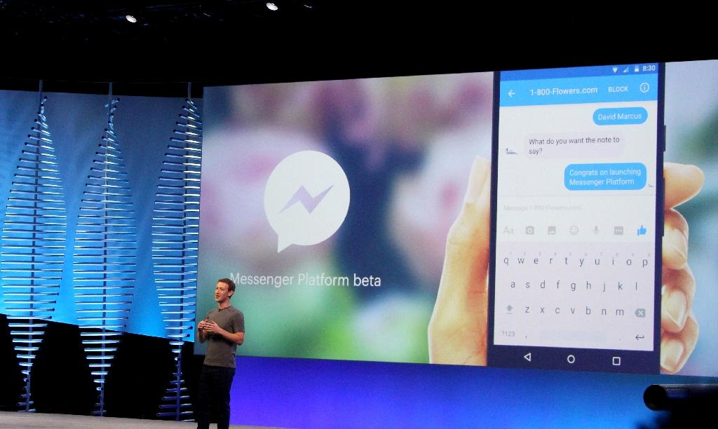 """Facebook chief and co-founder Mark Zuckerberg show developers at a 2016 conference how """"bots"""" can respond to natural language"""