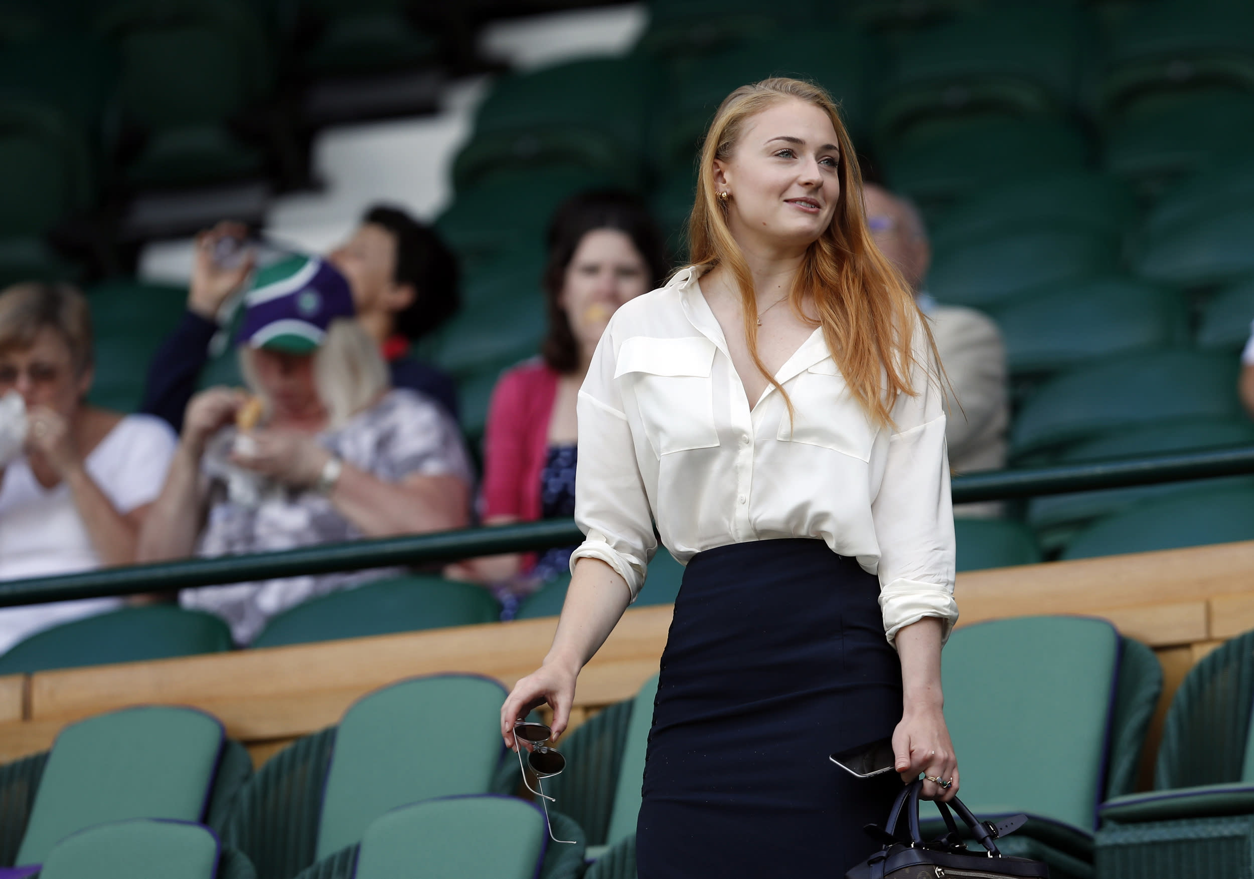 Actress Sophie Turner takes a seat in the Royal Box on day eleven of the Wimbledon Tennis Championships in London, Thursday, July 7, 2016. (AP Photo/Ben Curtis, pool)