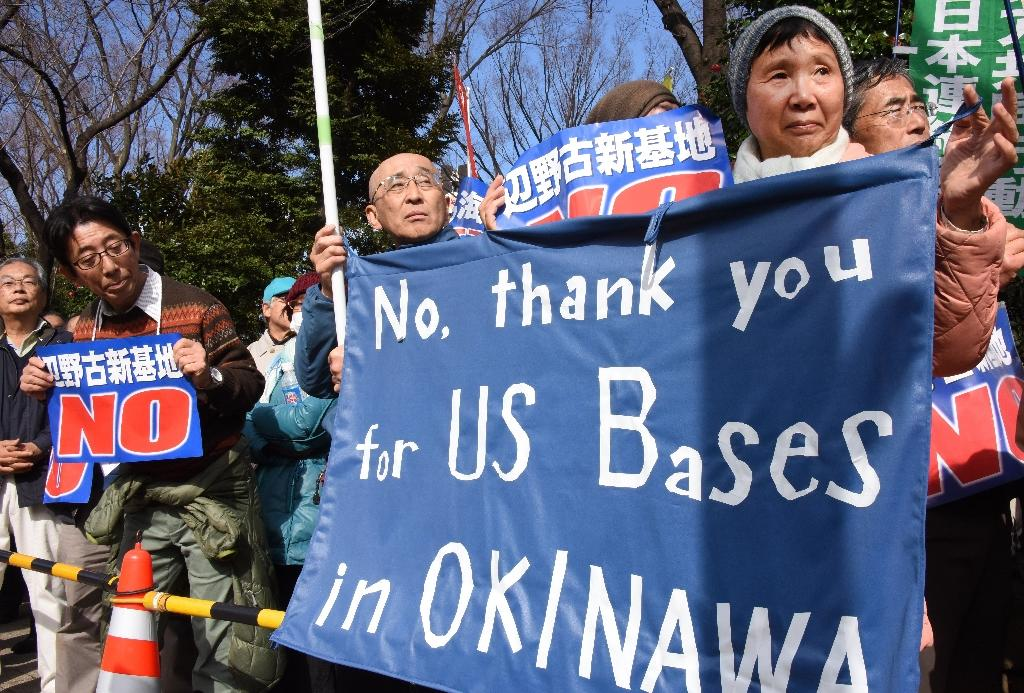 People rally against a new US military base in Okinawa, in front of the National Diet in Tokyo on February 21, 2016 (AFP Photo/Toru Yamanaka)