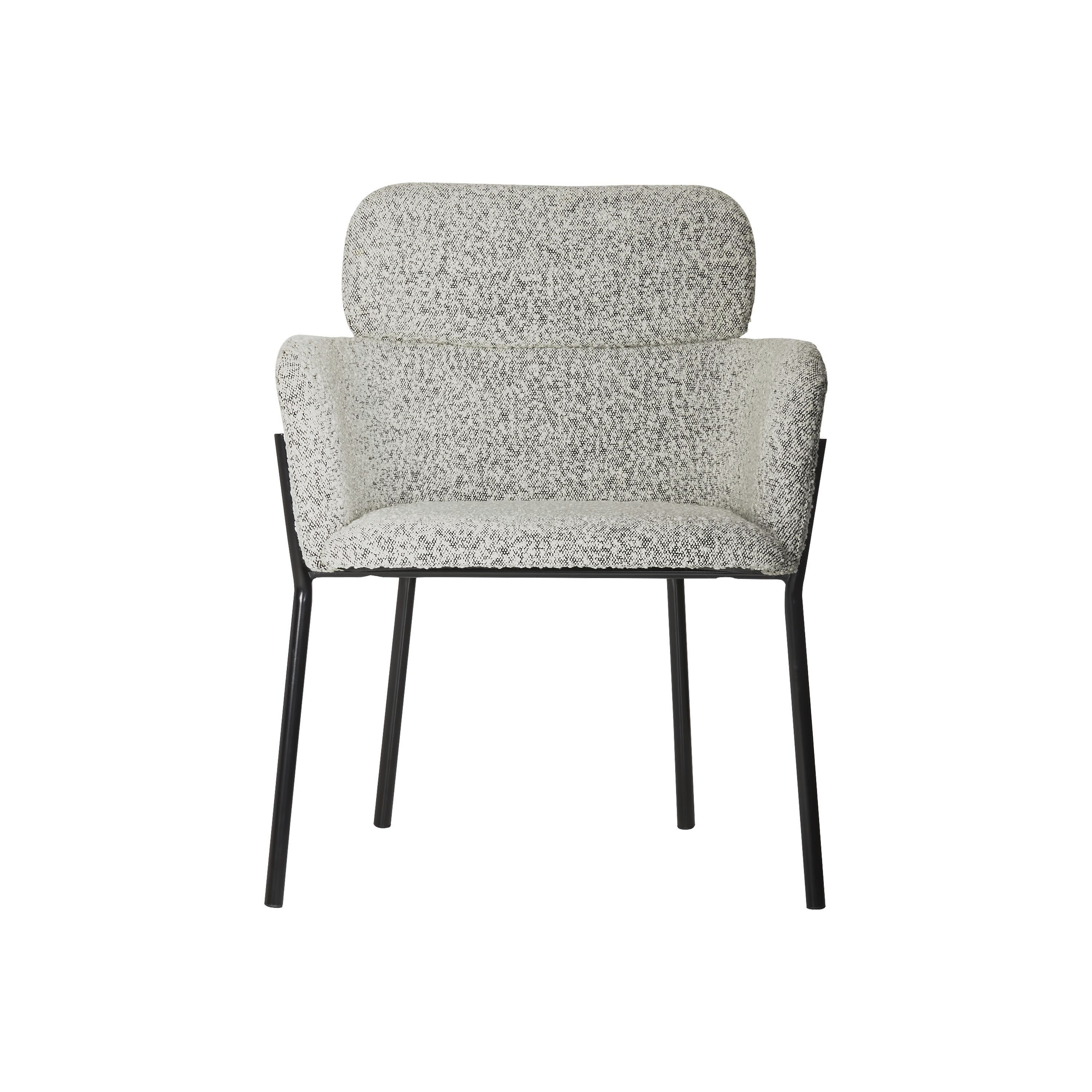 """This undated photo shows CB2's Azalea chair. Designer John McClain, whose studio is in Orlando, says one big trend he's seeing in fall décor is a range of deep, cozy textures like boucle and shearling. """"(They're) are cropping up on more than just pillows these days – entire sofas, chairs and headboards are sporting luscious upholstery reminiscent of lambs, puppies and ponies."""" CB2 has several options, including the Gwyneth side chair, Logan sofa and Azalea chair. (CB2 via AP)"""