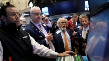 Wall Street ends higher on technology, energy boost