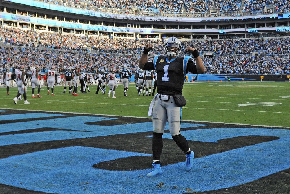Cam Newton and the Panthers are still in the running to host a playoff game as the NFC South champions. (AP)