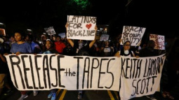 Charlotte marchers demand police release shooting tapes