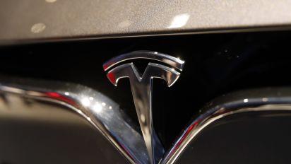 Tesla says robotaxis coming next year