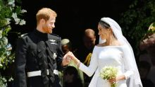 A body language expert on how Harry and Meghan's relationship has fared this past year