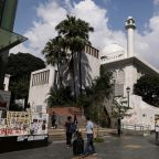 Apology accepted, Hong Kong's Muslims lament water cannon staining mosque