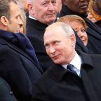 President Trump, Vladimir Putin greet each other in Paris