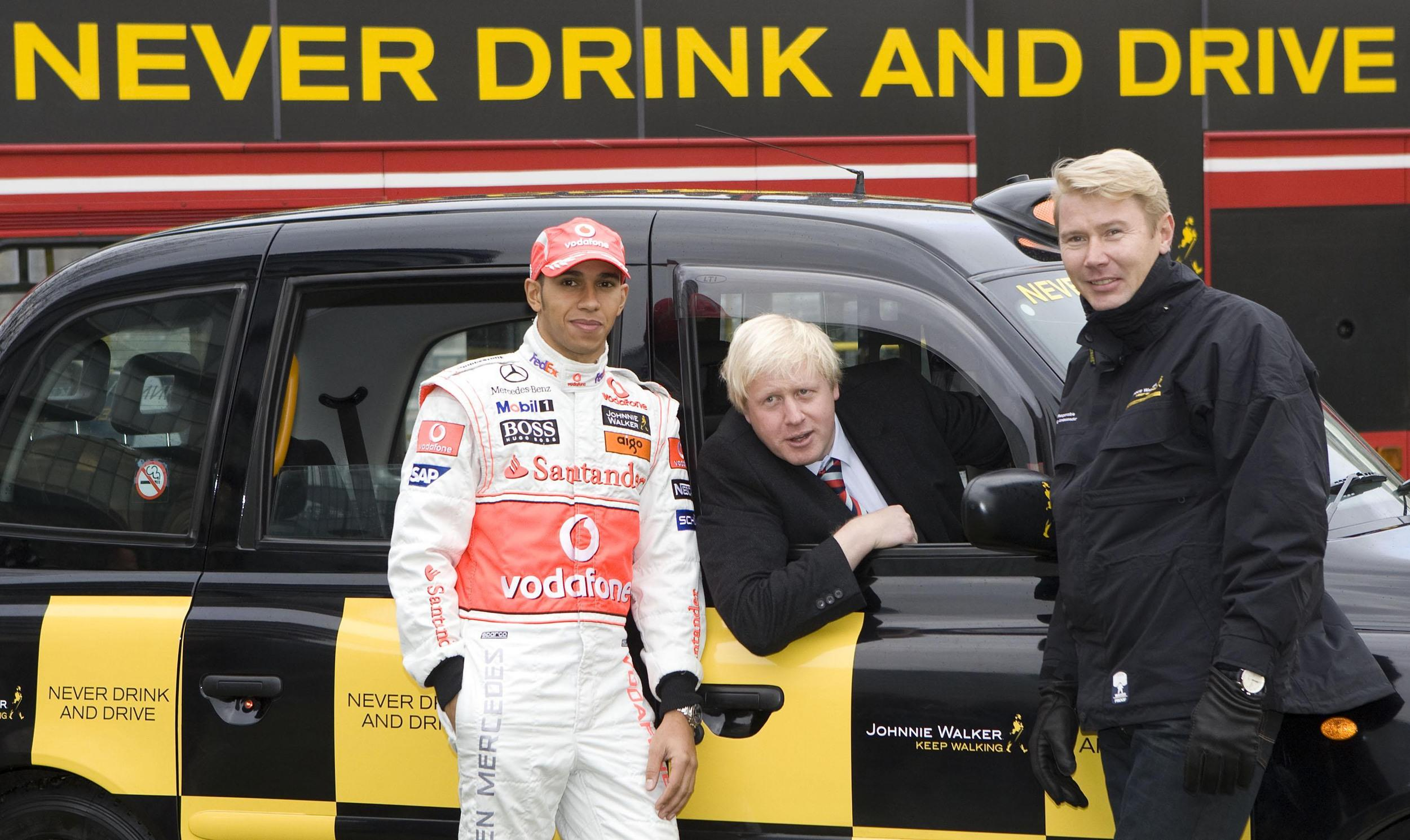 Retired Formula 1 World Champion Mika Hakkinen (right) and current Formula 1 World Champion Lewis Hamilton (left) join Mayor of London Boris Johnson in backing an anti-drink-drive campaign at Potters Fields Park in London.