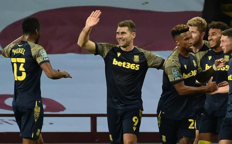 Stoke striker Sam Vokes (C) celebrates his winner at Aston Villa