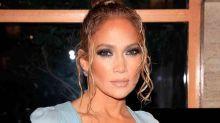 Jennifer Lopez's Bright Orange Pants Melt Into Her Steep Platform Sandals