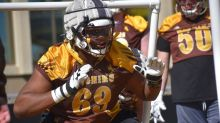 With his future in mind, Wyoming offensive lineman Eric Abojei sheds significant weight