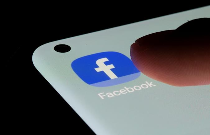 Facebook app is seen on a smartphone in this illustration taken, July 13, 2021. REUTERS/Dado Ruvic/Illustration