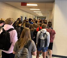 Students say they were suspended and others threatened with 'consequences' for posting photos of their school's packed hallways