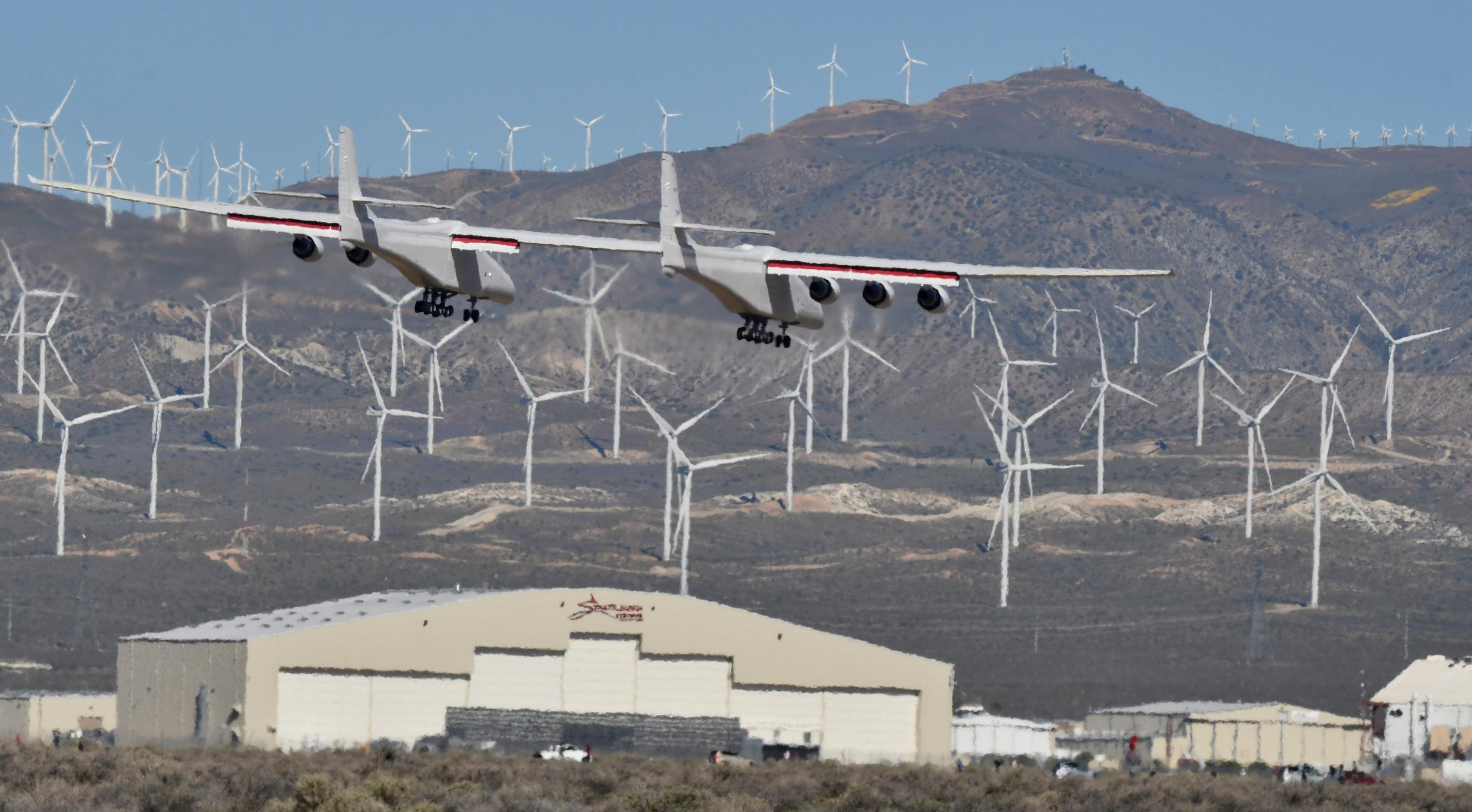 The world's largest airplane, built by the late Paul Allen's company Stratolaunch Systems, lands during its first test flight in Mojave, California, U.S. April 13, 2019.  REUTERS/Gene Blevins