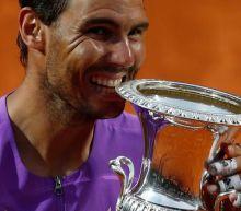 Tennis-Nadal overcomes blip to scythe down Djokovic in Rome final