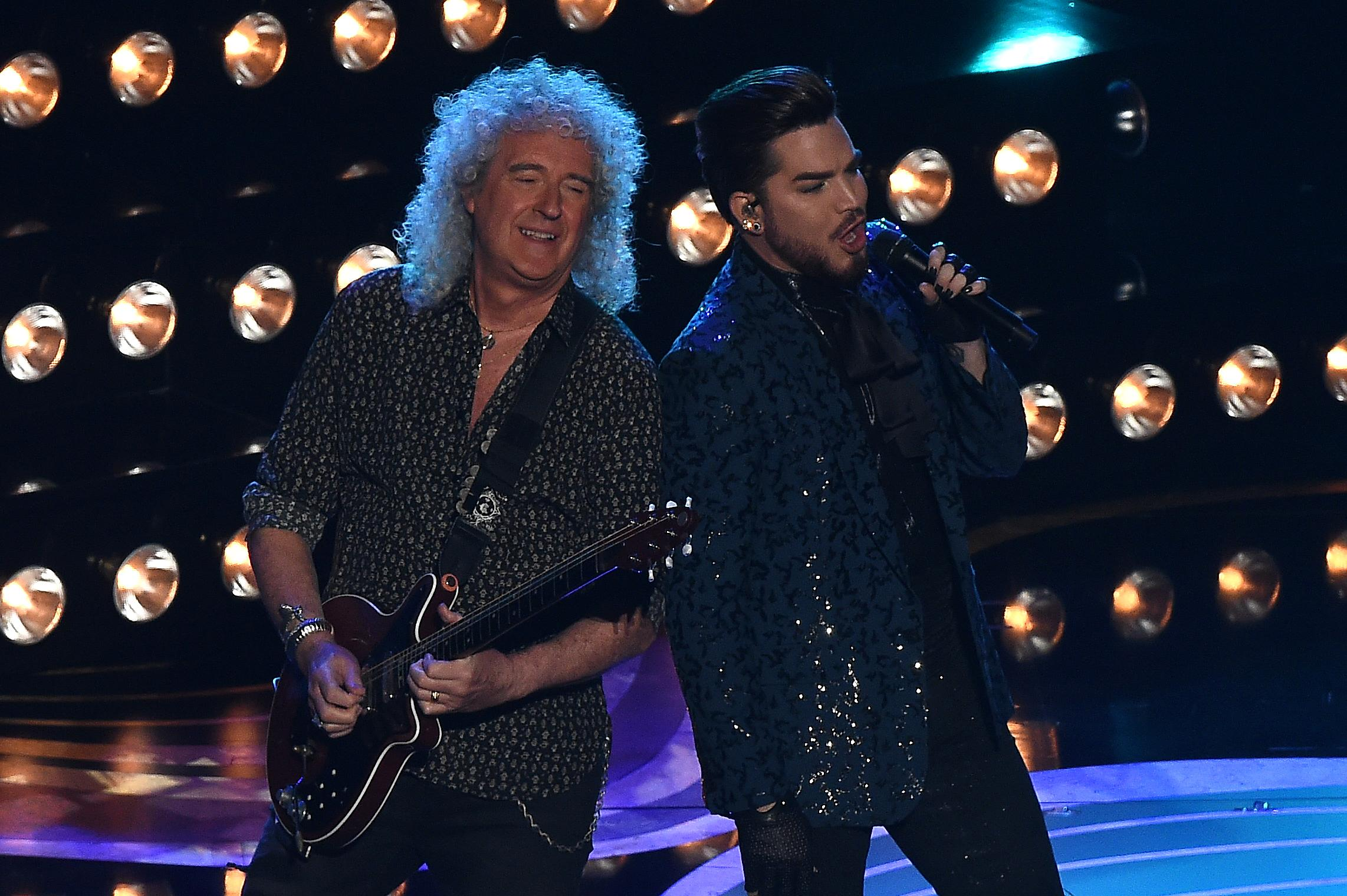 Member of British rock band Queen Brian May and US singer-songwriter Adam Lambert performs during the 91st Annual Academy Awards at the Dolby Theatre in Hollywood, California on February 24, 2019. (Photo by VALERIE MACON / AFP)        (Photo credit should read VALERIE MACON/AFP/Getty Images)