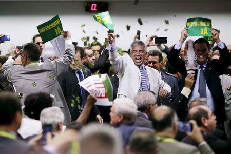 Members of the impeachment committee celebrate after voting on the impeachment of Brazilian President Dilma Rousseff at the National Congress in Brasilia, Brazil. REUTERS/Ueslei Marcelino