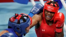Olympics-Boxing-After narrow escape from home fire, American Jones eyes gold